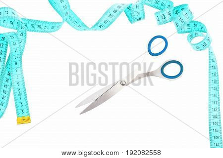 Scissors And Twisted Cyan Measuring Tape Isolated On White Background