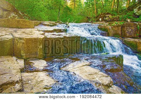 water runs into the Woods, little rapids of great waterfalls,Taiga.