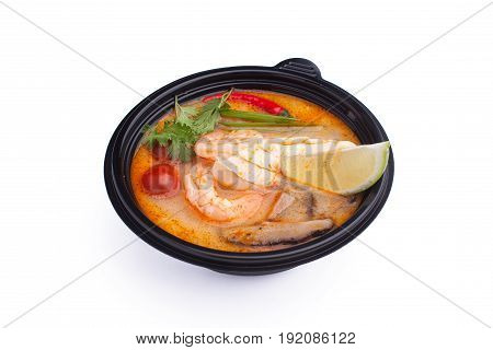 Miso soup in a black plastic plate on a white background