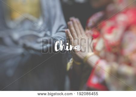 China. Woman hand respect to buddha statue.
