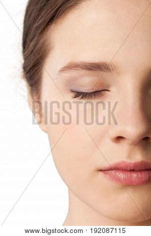 Young pretty woman eye closed close up make up white