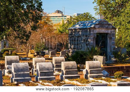 Atlanta, Georgia, USA - December 22, 2016: Group of tombstones and crypt on the Oakland Cemetery in sunny autumn day
