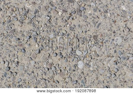 View on a stony Ground. Close-up of Stones on the Ground. Natural Stone Background.