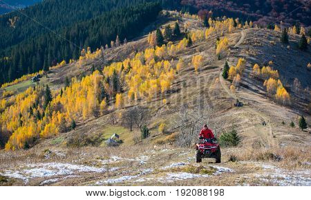 Off-road Vehicle With Man On A Mountain Road Passes To The Top Of The Mountain Followed By A Beautif
