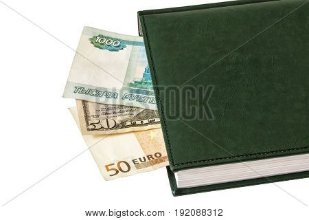 Between the sheets of the closed diary are visible parts of $ 50 50 euros and 1000 Russian rubles