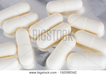 Pharmacy Theme, White Medicine Pills Isolated On Foil Background