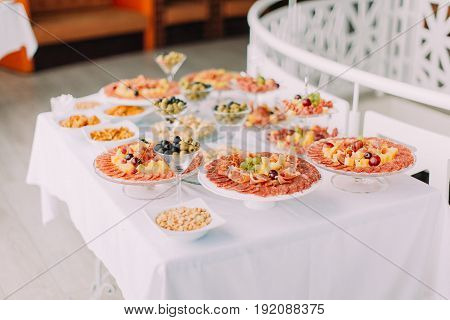 Side view of the meat dishes with cheese. Wedding table set