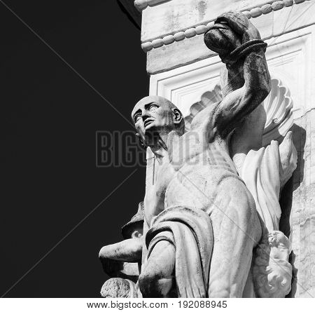 Facade of the historic Certosa di Pavia (Lombardy Italy) medieval monument. Statue. Black and white