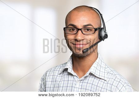 Smiling portrait man headset afro american white background