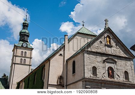 Megève, France - June 25, 2016. Close-up of Church of Saint Jean Baptiste and steeple in Megève, a famous ski resort located in Haute-Savoie Province, near the Mont Blanc in the French Alps