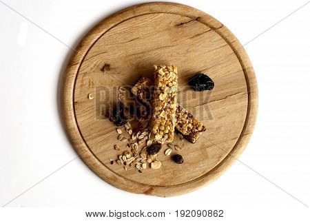 Muesli snack in the white background on a wooden board