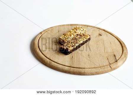 Muesli snacks on a wooden board in the white background