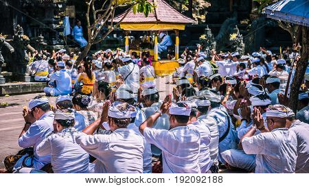 GOA LAWAH, BALI, INDONESIA - November 3, 2016: Balinese praying on ceremony at Pura Goa Lawah temple, Bali - Indonesia.