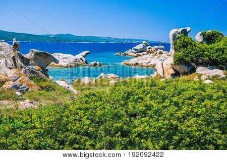 Costline with granite rocks and azure water near Porto Pollo, Sardinia, Italy.