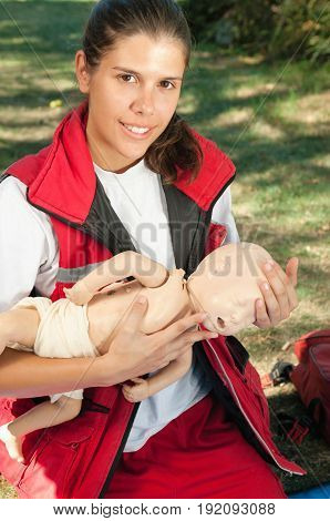 Infant Cpr On Dummy Outdoors, Color Image, Vertical Image