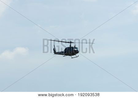 BERLIN GERMANY - JUNE 03 2016: Demonstration flight of military helicopter Bell UH-1 Iroquois. German Army. Exhibition ILA Berlin Air Show 2016