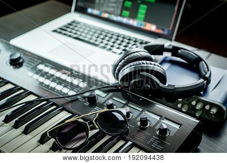 Computer Music Studio equipment with sunglasses on synthesizer