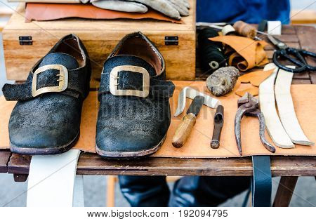 Middle Agility Shoes in Workshop with tools of the shoemaker