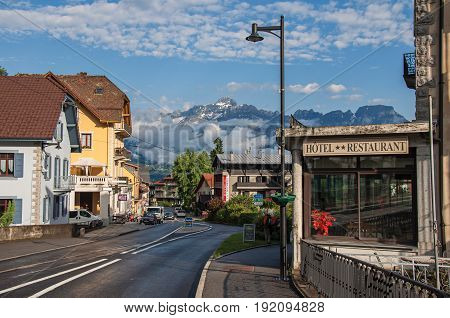 Saint-Gervais-Les-Bains, France - June 25, 2016. Street with cars and shops in the district of Le Fayet, a famous ski resort located in Haute-Savoie Province, near the Mont Blanc in the French Alps
