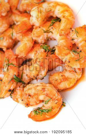Fried tiger prawns with herbs and spices on a white background. Selective focus.
