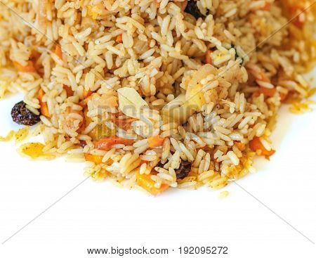 Pilaf with vegetables raisins and herbs on a white background. Healthy vegetarian food. Selective focus.