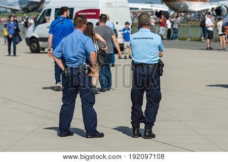 BERLIN GERMANY - JUNE 03 2016: The representative of the police and gendarmerie on the airfield. Ensuring public order. Exhibition ILA Berlin Air Show 2016