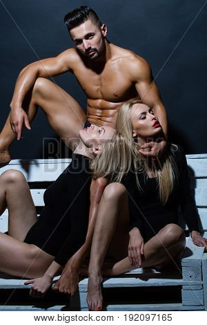 Love Relations Of Man With Muscular Body With Twin Girls