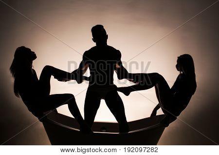 Women With Long Legs Sitting In Bath Tub With Man