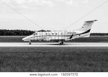 BERLIN GERMANY - JUNE 03 2016: Light business jet Embraer EMB-505 Phenom 300. Black and white. Exhibition ILA Berlin Air Show 2016