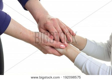 mom holding her daughter by the hand isolated on white background
