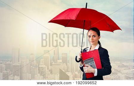 Beautiful young umbrella woman real estate urban scene color