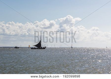 Black Sailboat next to Marken, The Netherland