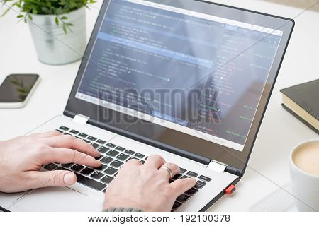 Coding web pages. Work at the computer. Programmer at work.