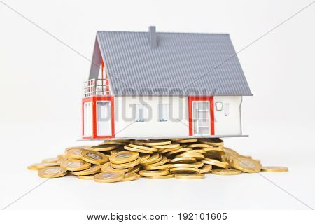 Concept of a detached house.  Mortgage investments.
