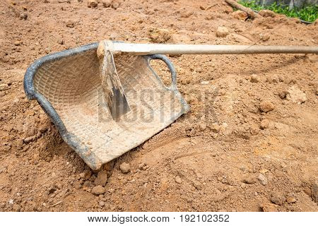 industry consrtuction site work hoe and basket on ground