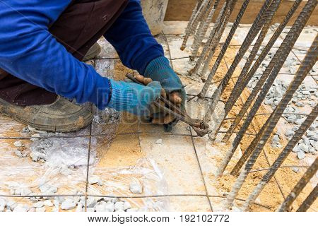 Closeup image building construction site work steel wire tie