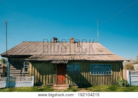 Old Russian Traditional Wooden House In Village Or Countryside Of Belarus Or Russia Countries.
