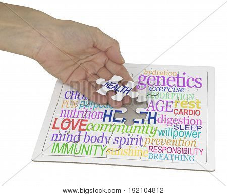 Health can be puzzling word cloud  - hand holding a jigsaw puzzle piece showing the word HEALTH, the remainder of the puzzle contains a health word cloud on white background