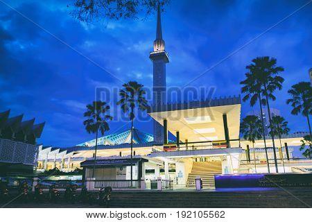 Kuala Lumpur, Malaysia - February 11, 2016: The minaret that towers above the National Mosque Masjid Negara at night, Kuala Lumpur, Malaysia.