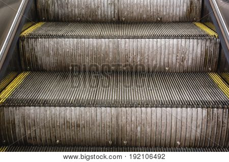 Steps of the escalator in the metro, toned