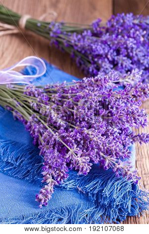 Bunch of lavander on old wooden table.