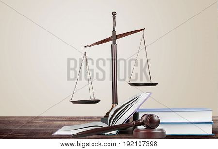 Justice books scales background paper isolated closeup
