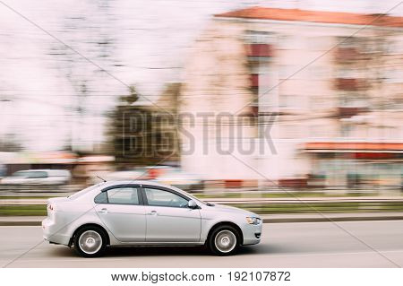 Gomel, Belarus - April 17, 2017: Gray Color Sedan Car Mitsubishi Lancer In Fast Motion On Street. The Mitsubishi Lancer Is A Compact Car Produced By The Japanese Manufacturer Mitsubishi Since 1973