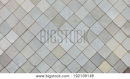 Brown stone tiles roof texture architecture background seamless pattern detail of house close up