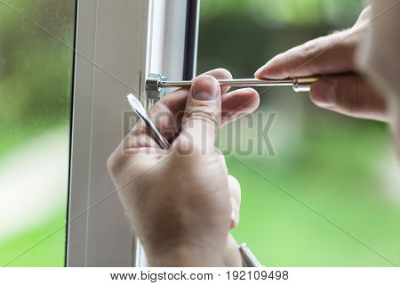 Man frame window repair repairman fixing plastic steel window
