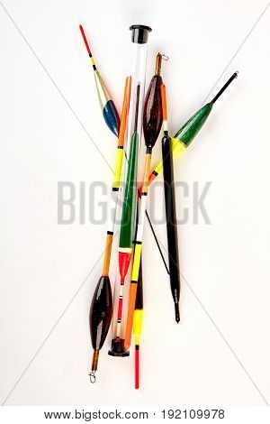 Vertical image of fishing floats. Set of tackle tools, white background.