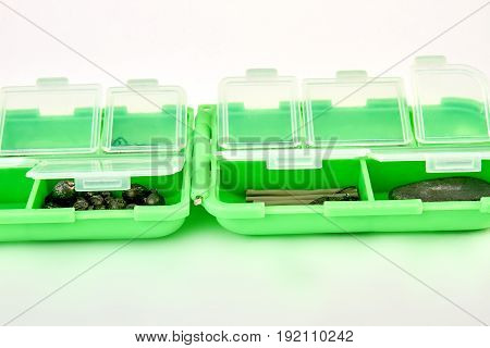 Closeup of opened fishing container. Storage for fishing baits.