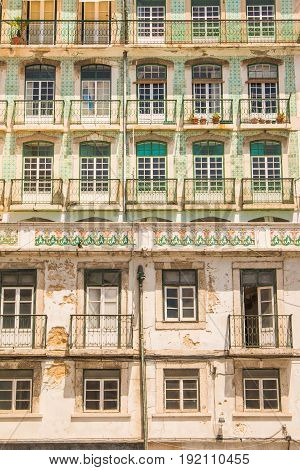 Typical colorful rusty facades wall on houses in Lisbon, Portugal