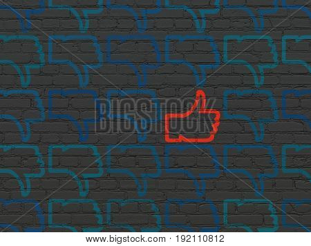 Social media concept: rows of Painted blue thumb down icons around red thumb up icon on Black Brick wall background