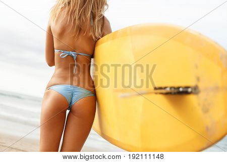 Beautiful Sporty Surfer Girl At The Beach.
